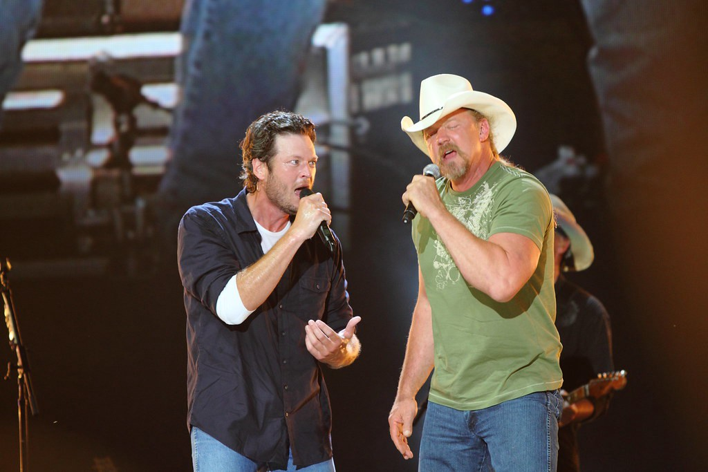 Two shabbily-dressed hillbillies singing a song