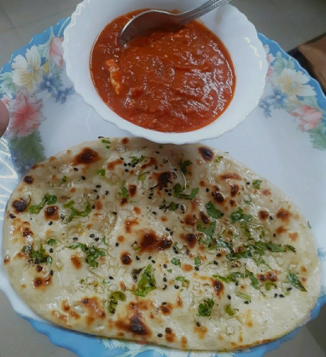 Garlic naan served with hot and spicy paneer butter masala.