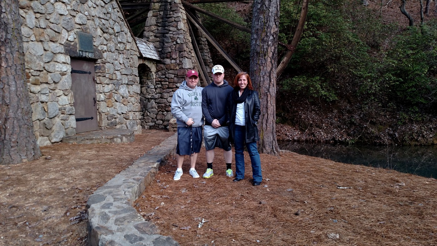 Photo of me, my son, and husband out exploring in North Georgia