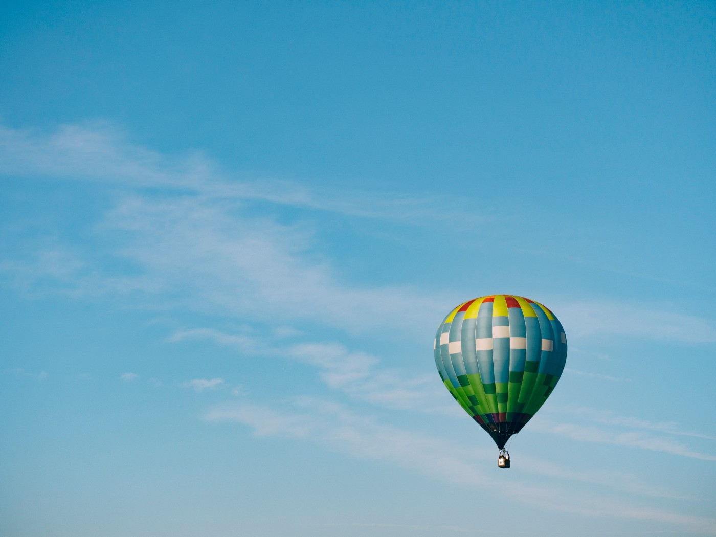 colorful hot air balloon against a blue sky
