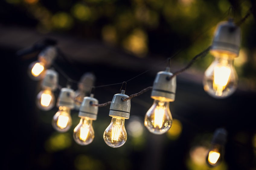 A lit string of outdoor patio lights.