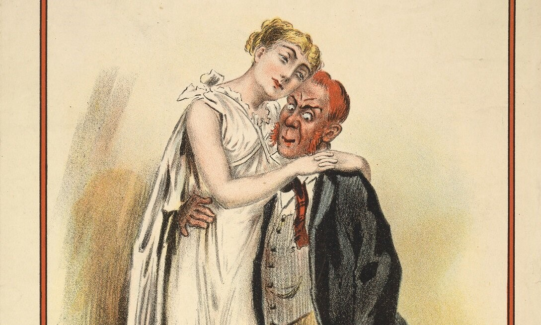 A blonde woman is hugging a red-haired man with a cunning look on his face