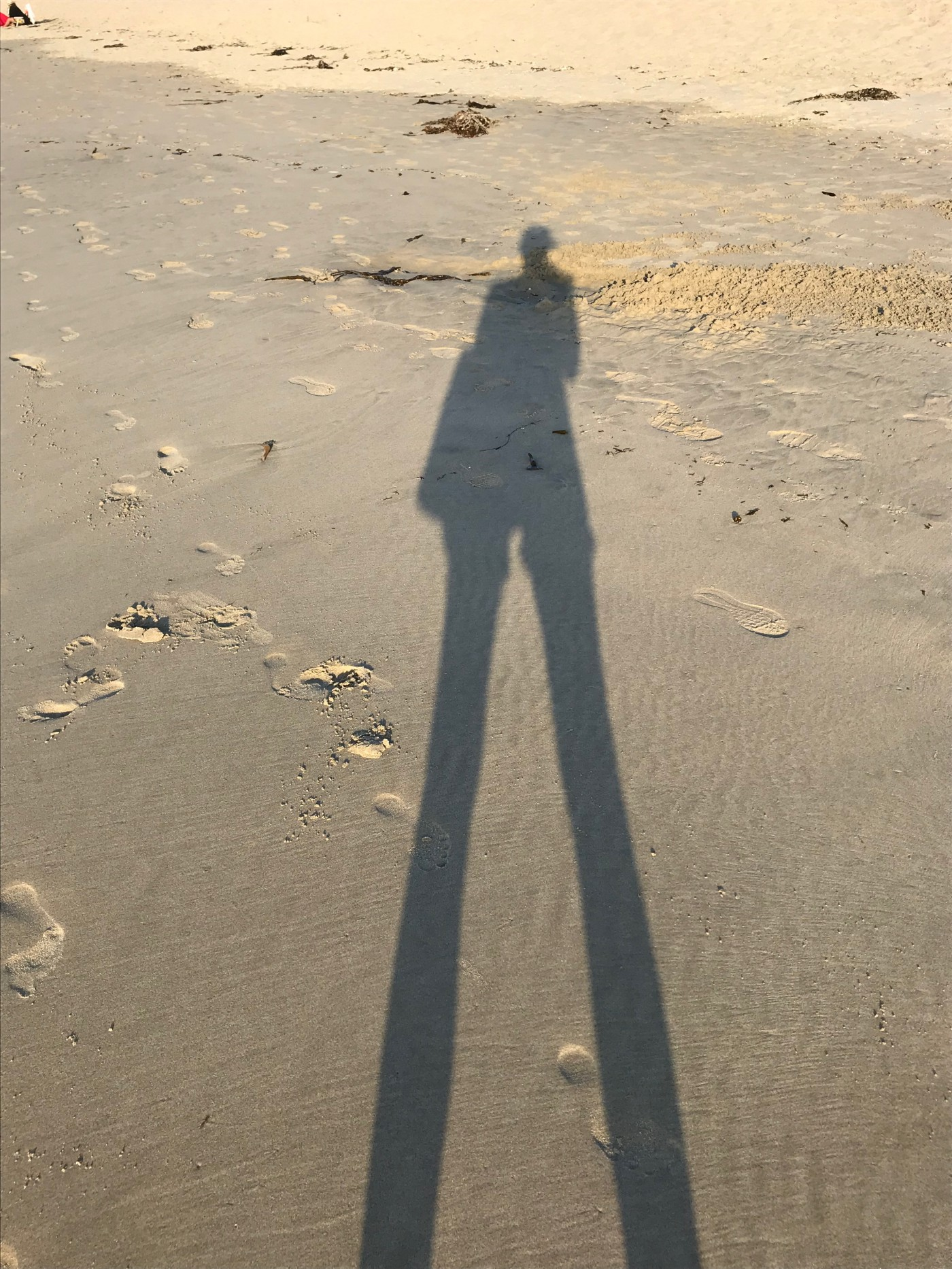 Shadow of figure on beach