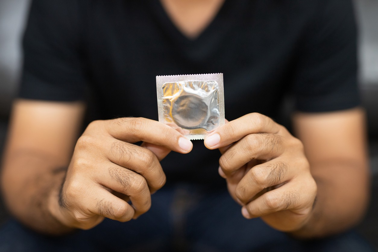 Close up Male hand holding Condom.