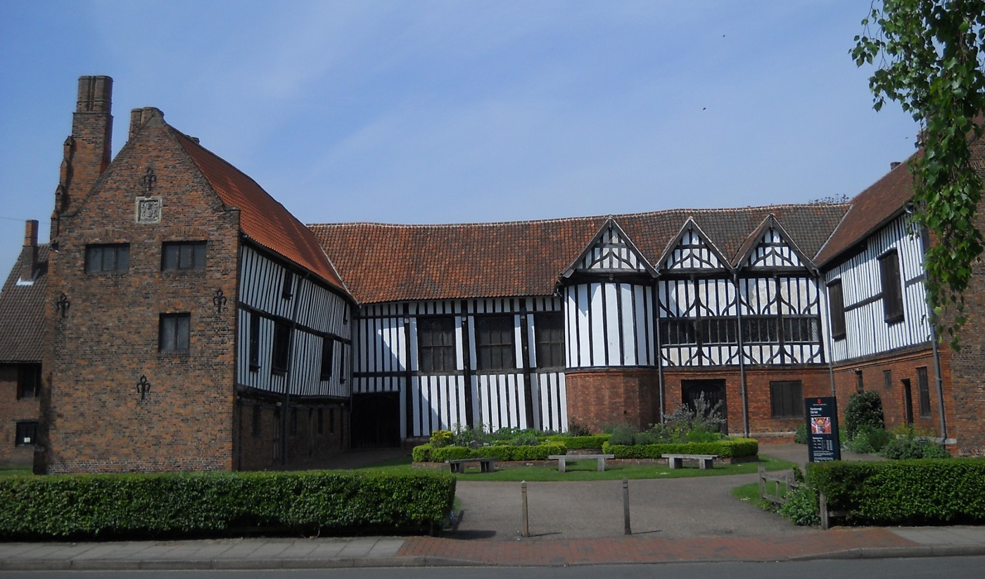 Horse-shoe shaped Gainsborough Old Hall, built 1460, in red brick and black lath & white-washed plaster.