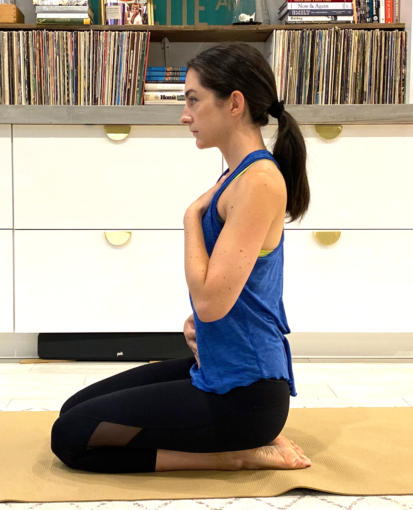 Author on yoga mat touching their stomach