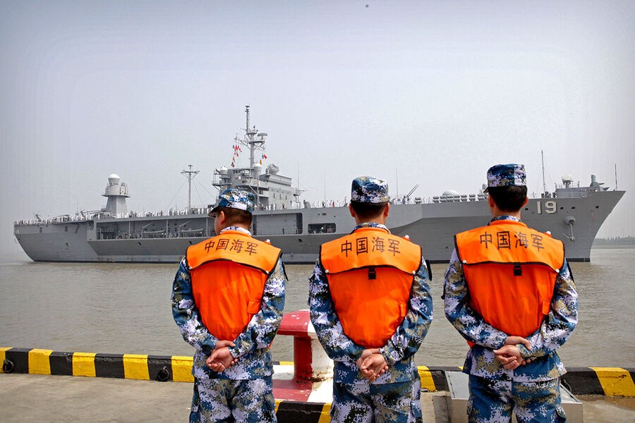 AP/file—Sailors from the Chinese navy watch as the U.S.S. Blue Ridge arrives in Shanghai on May 6, 2016.