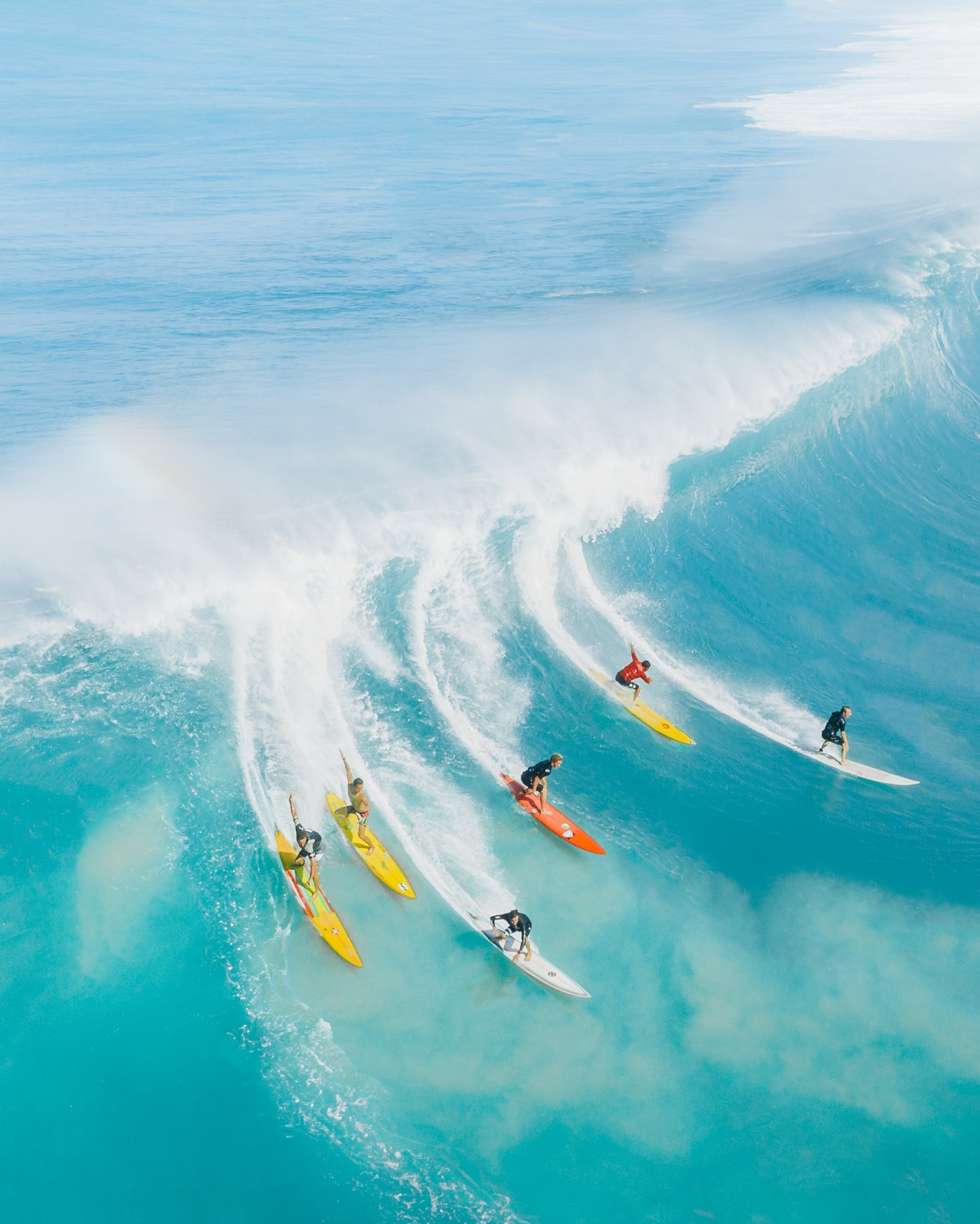 Five benefits of reading other people's work, as represented by six surfers on a big wave