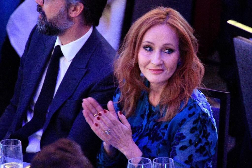 J.K. Rowling clapping at an event.