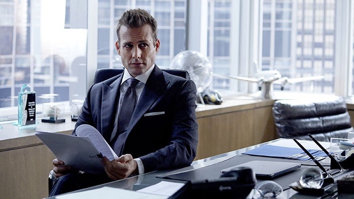 "Harvey Specter seated at his desk. Fictional character of the TV show ""Suits""."