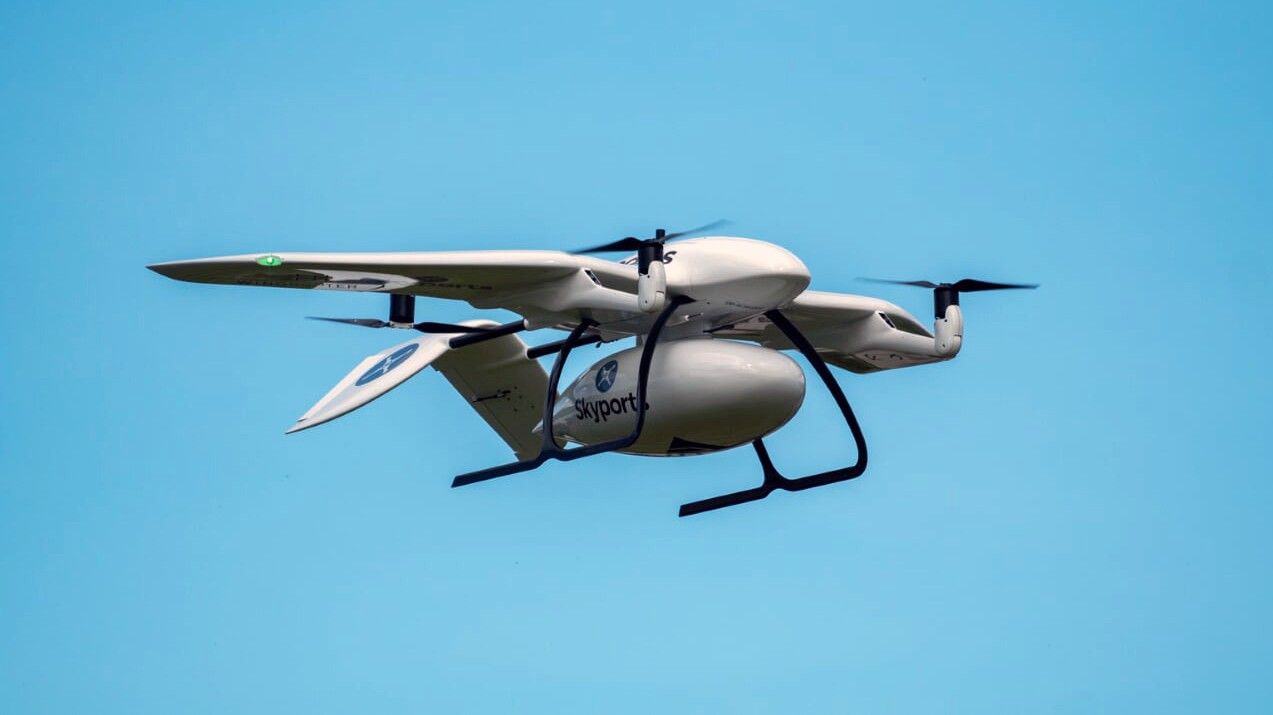 A Wingcopter drone carrying PPE and testing supplies operated by Skyports and insured by Flock