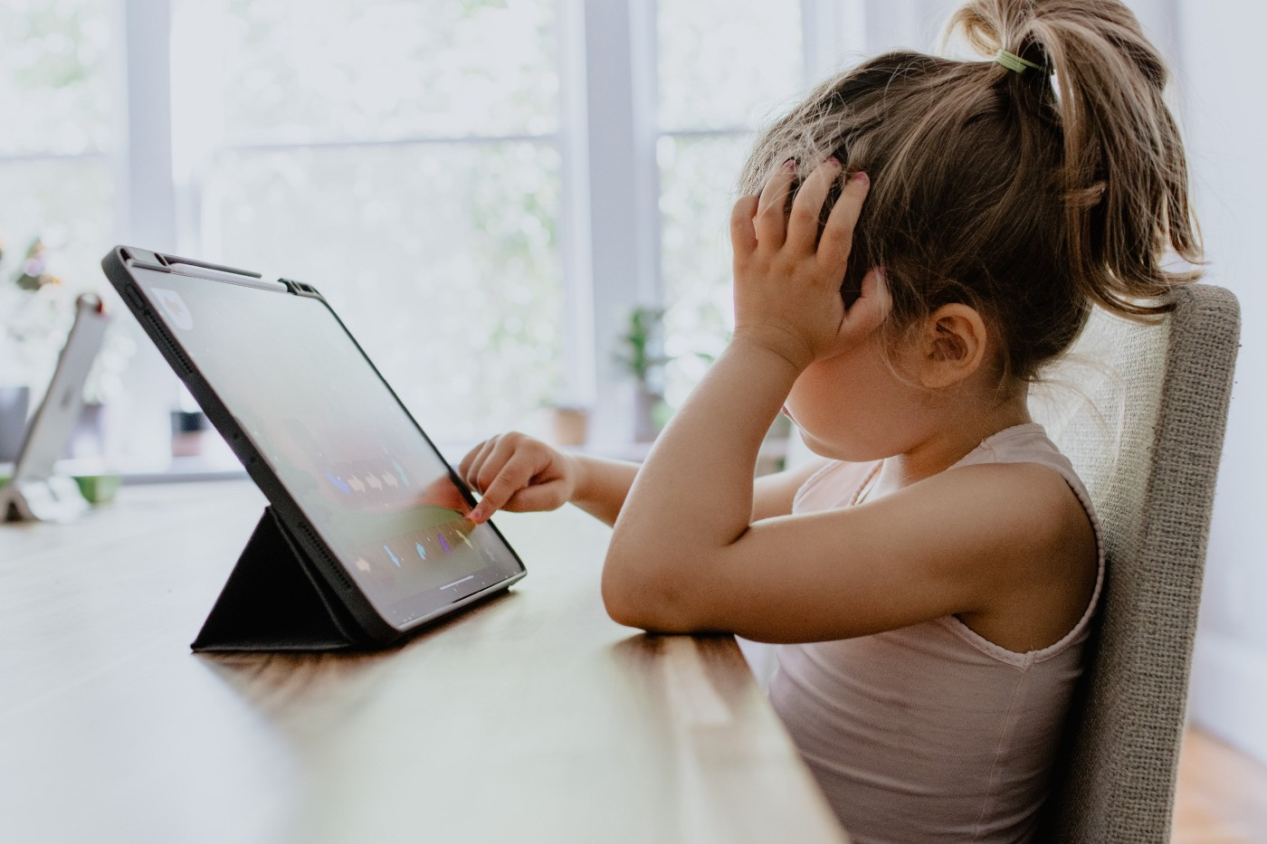 Frustrated child on tablet