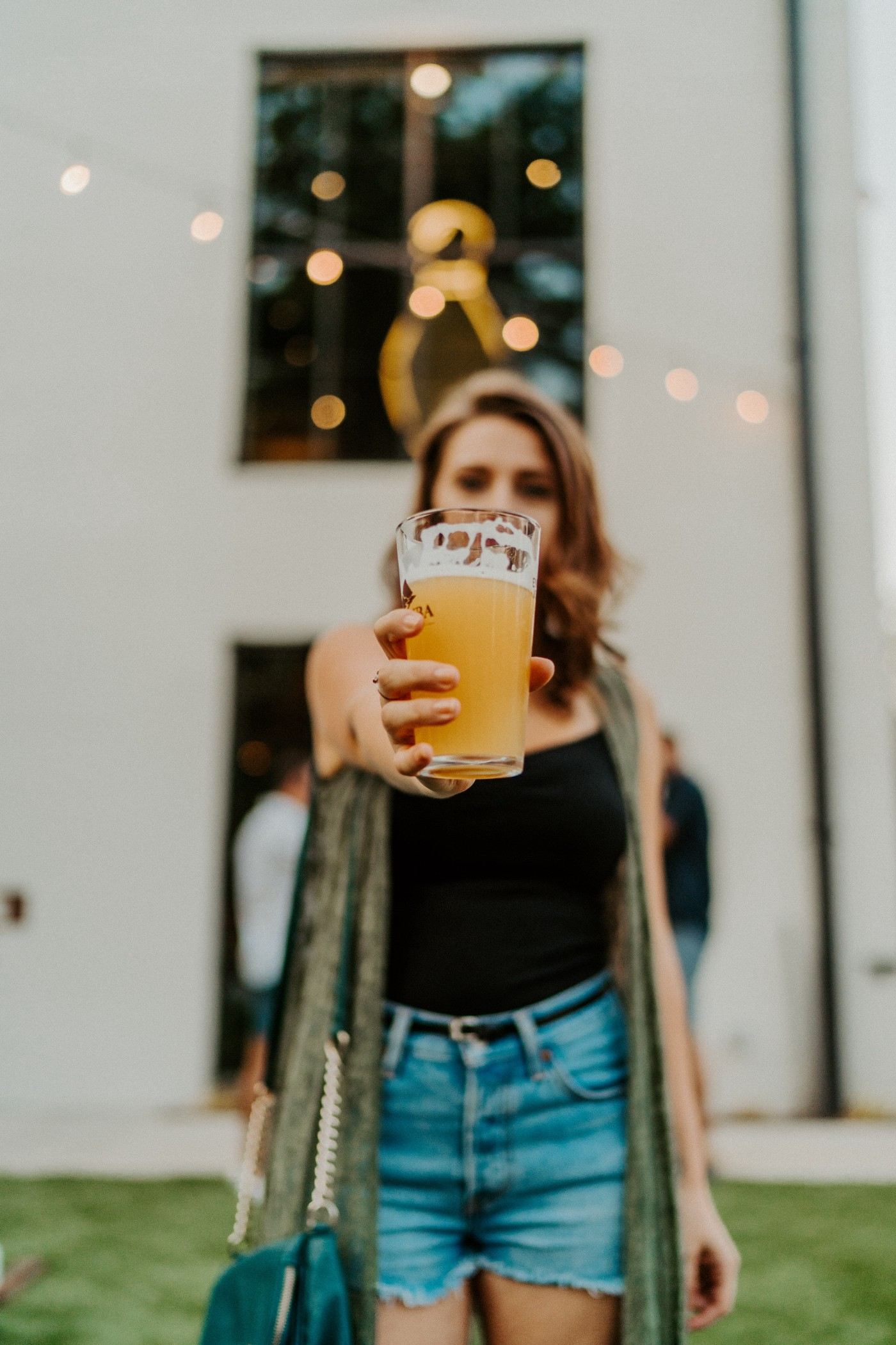 a young woman holding a beer—craft beer marketing ideas