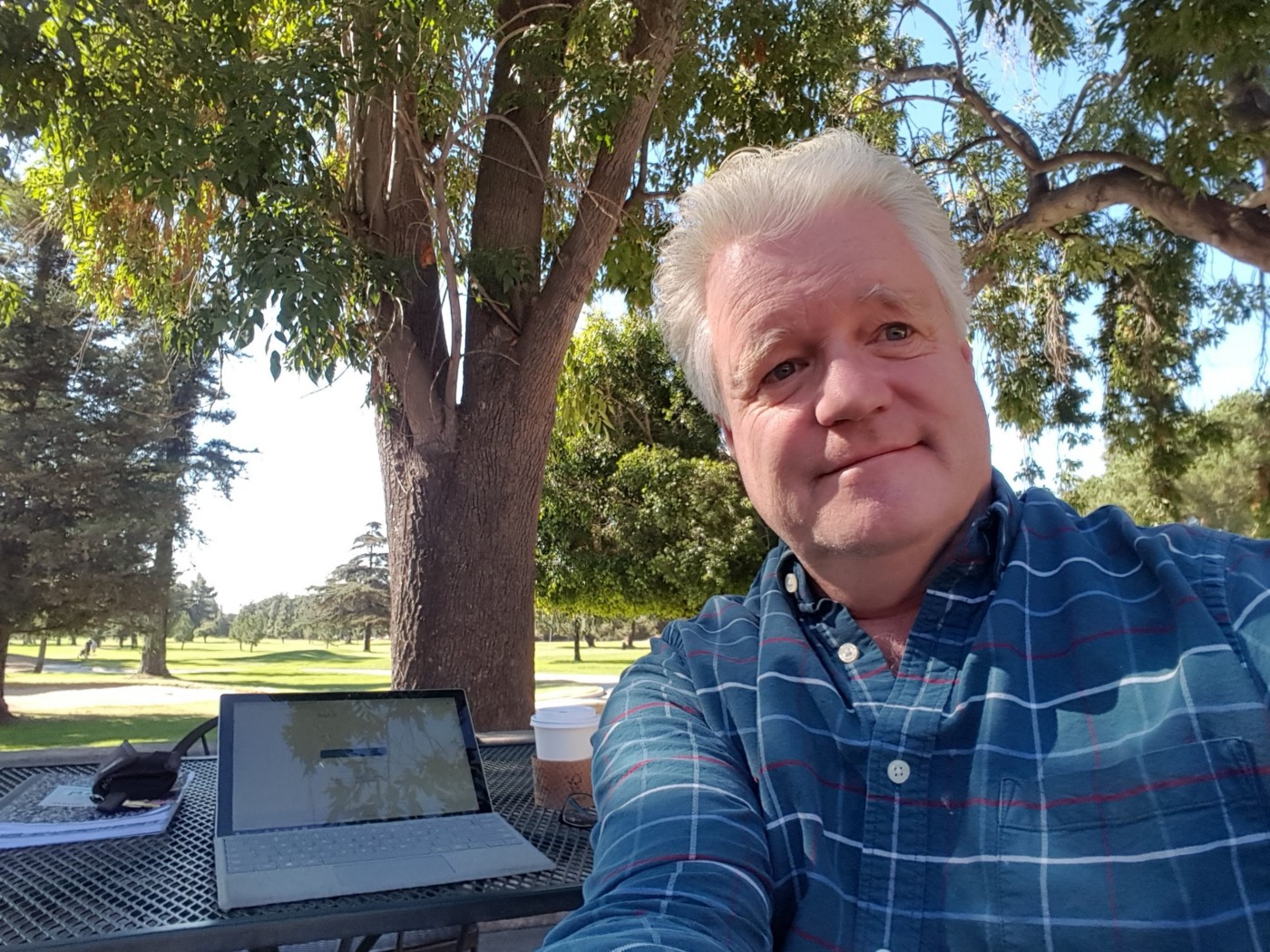 Don Simkovich sitting in front of laptop outdoors.