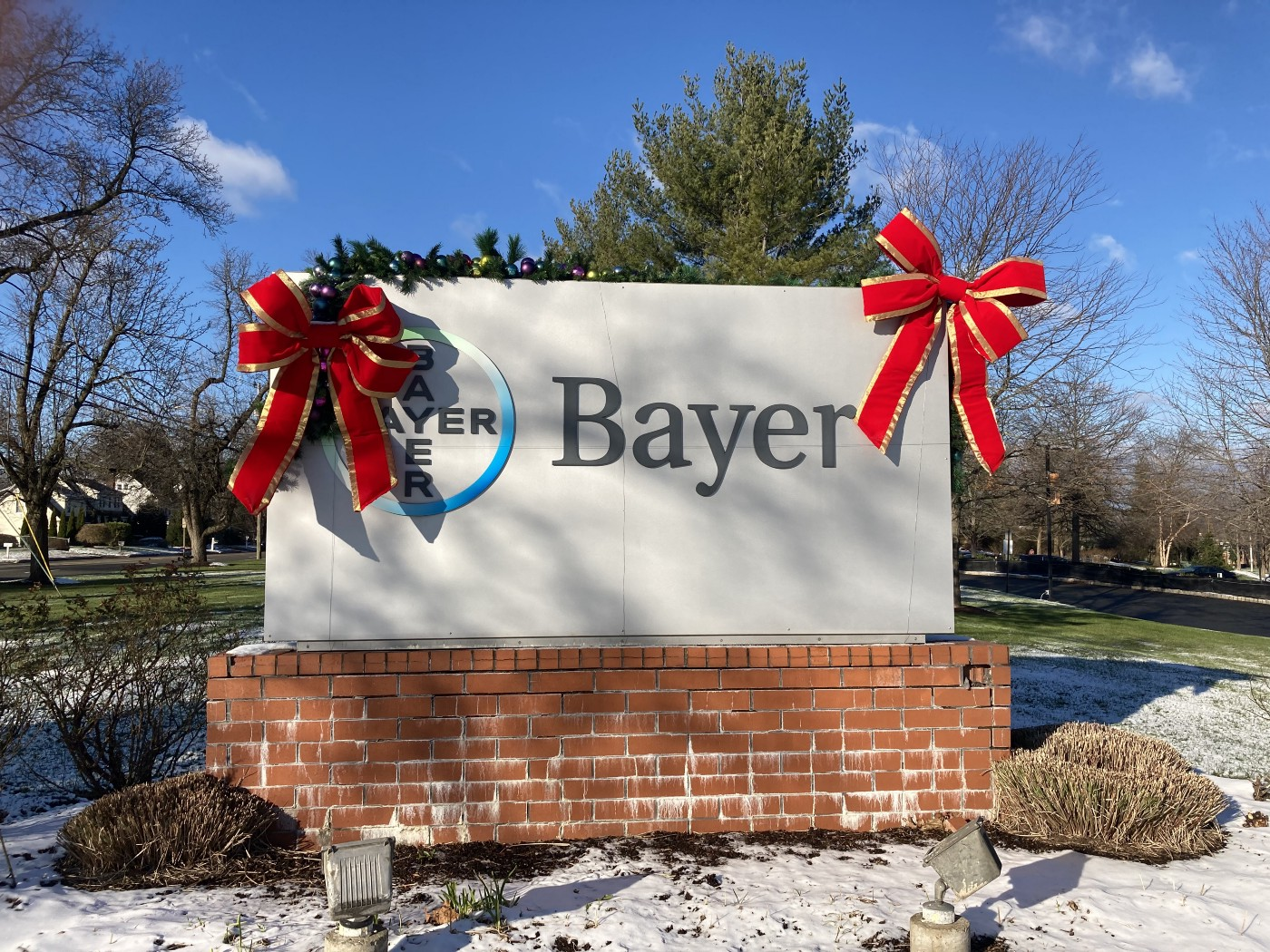 The front lawn of Bayer's US headquarters with a sign, which fittingly resembles a tombstone.