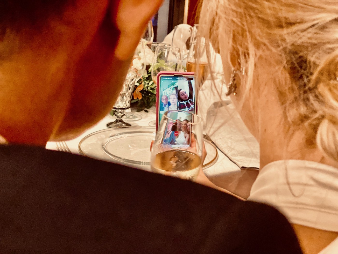 A couple speaking with loved ones via Zoom during their pandemic wedding