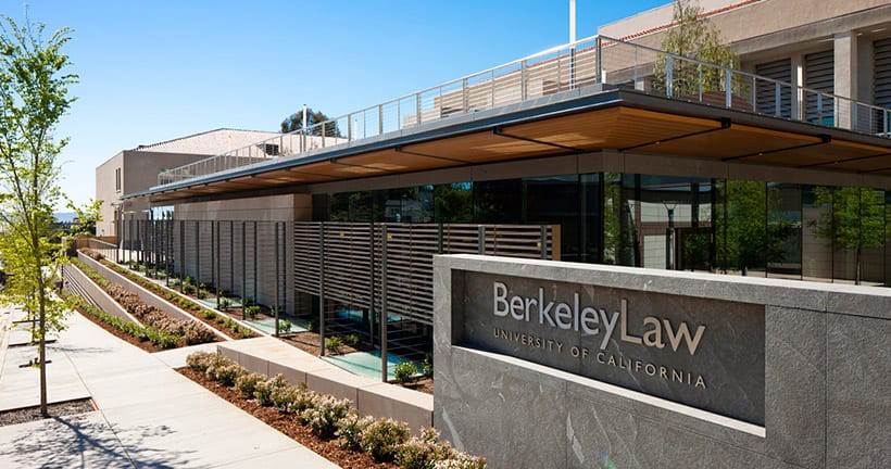 Photo of Berkeley Law's building and the sign with its name