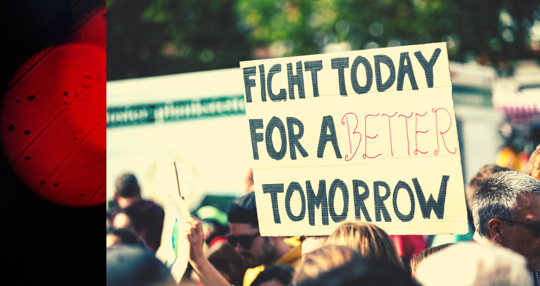 """A protest sign reads """"Fight Today For A Better Tomorrow."""""""