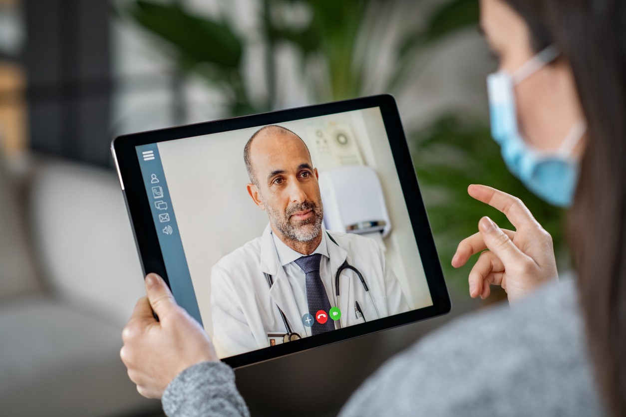 Image of a doctor on an Ipad doing a virtual call.