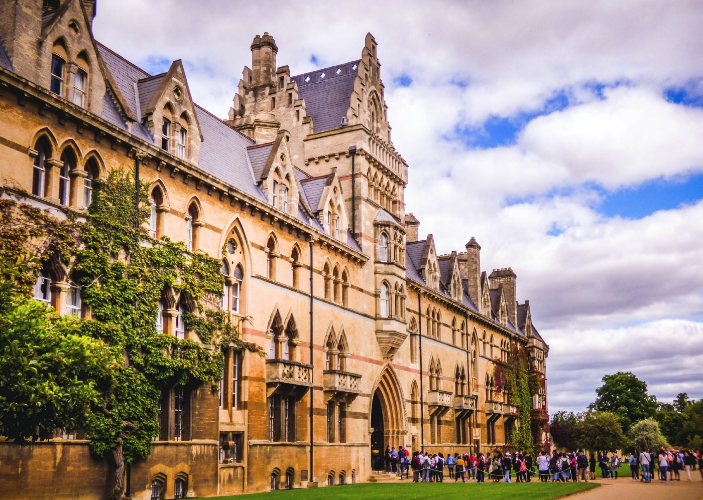 The University of Oxford with a line of students entering a building