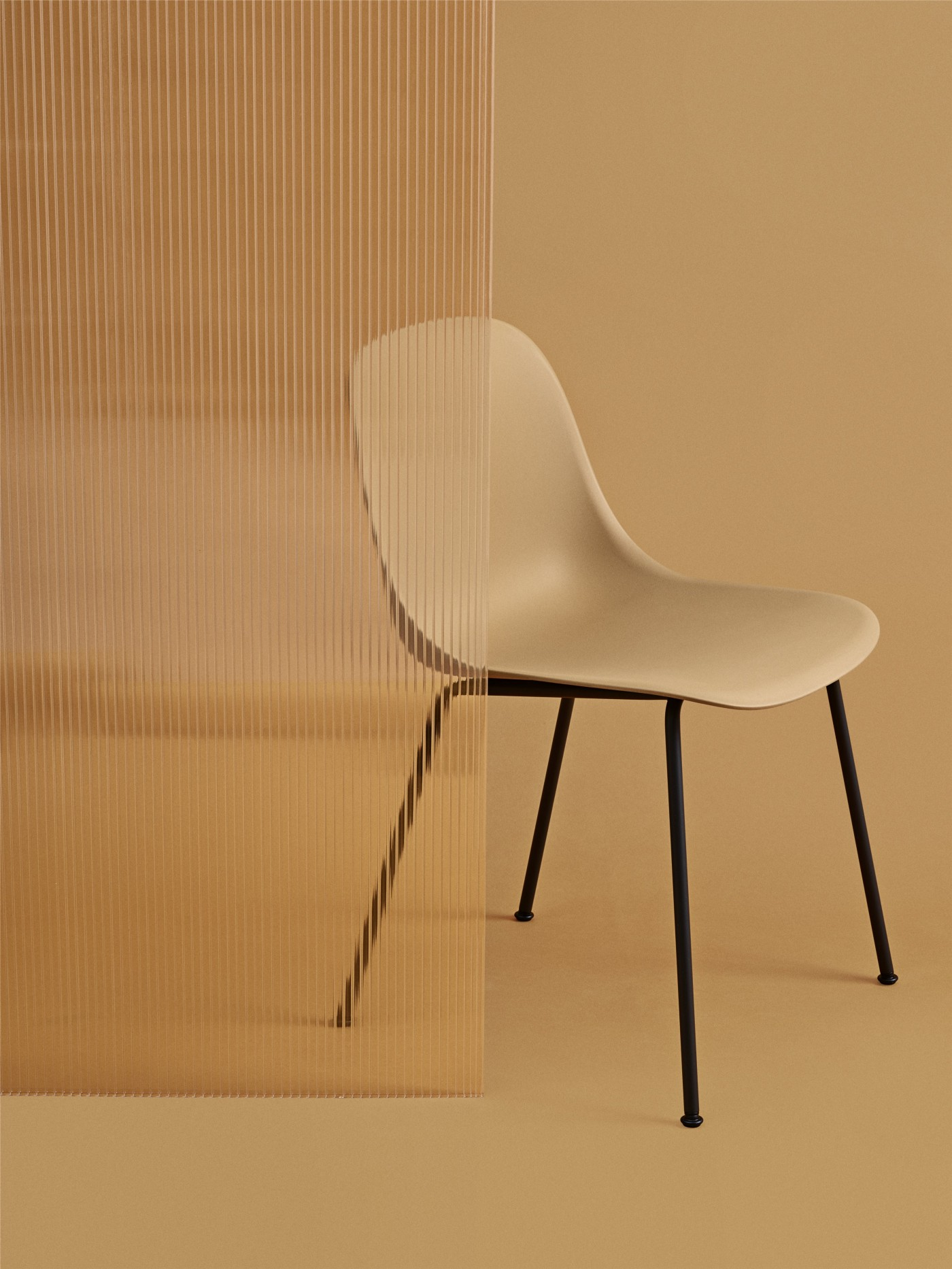 Contemporary, Danish dining chair in ochre finish with black metal legs.