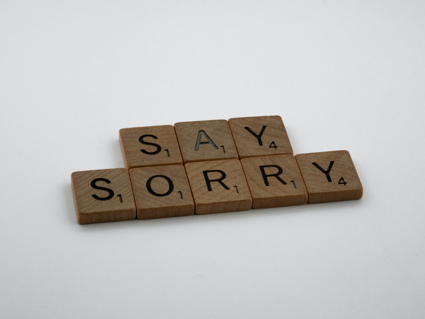 """Scrabble tiles that spell out the words """"Say Sorry"""""""