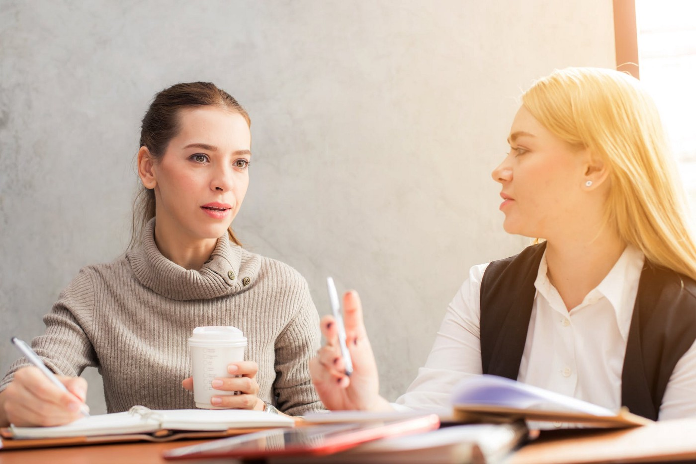 woman talking to another woman