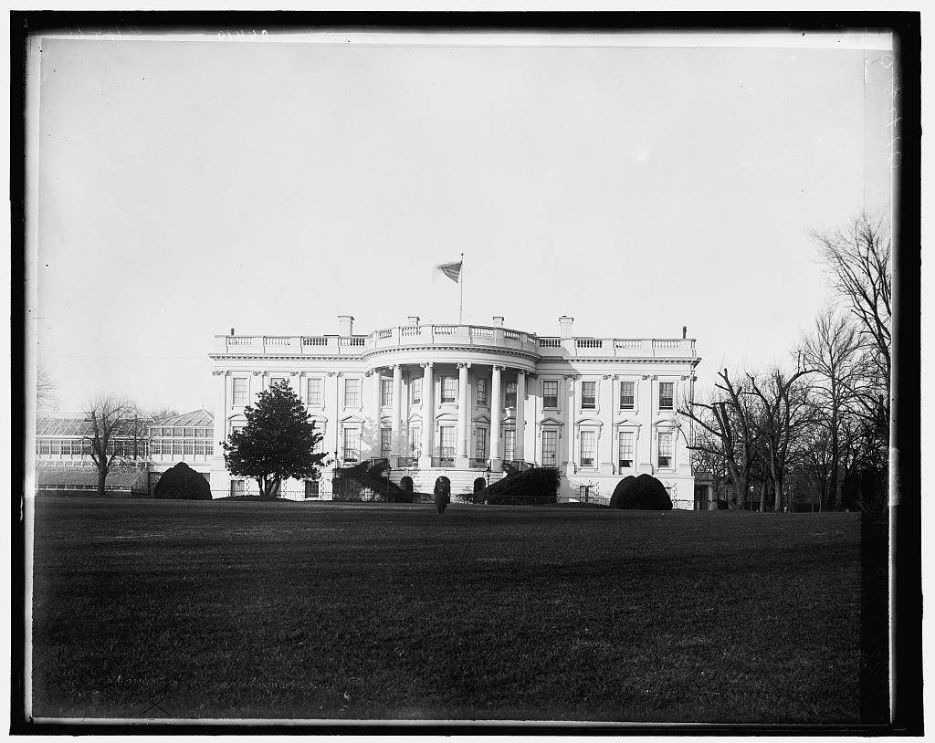 archival black and white photo of 1600 Pennsylvania Ave White House