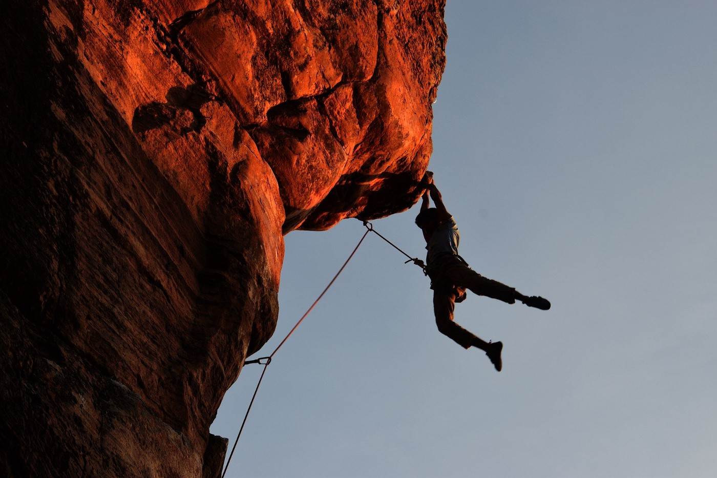 Person climbing with a rope