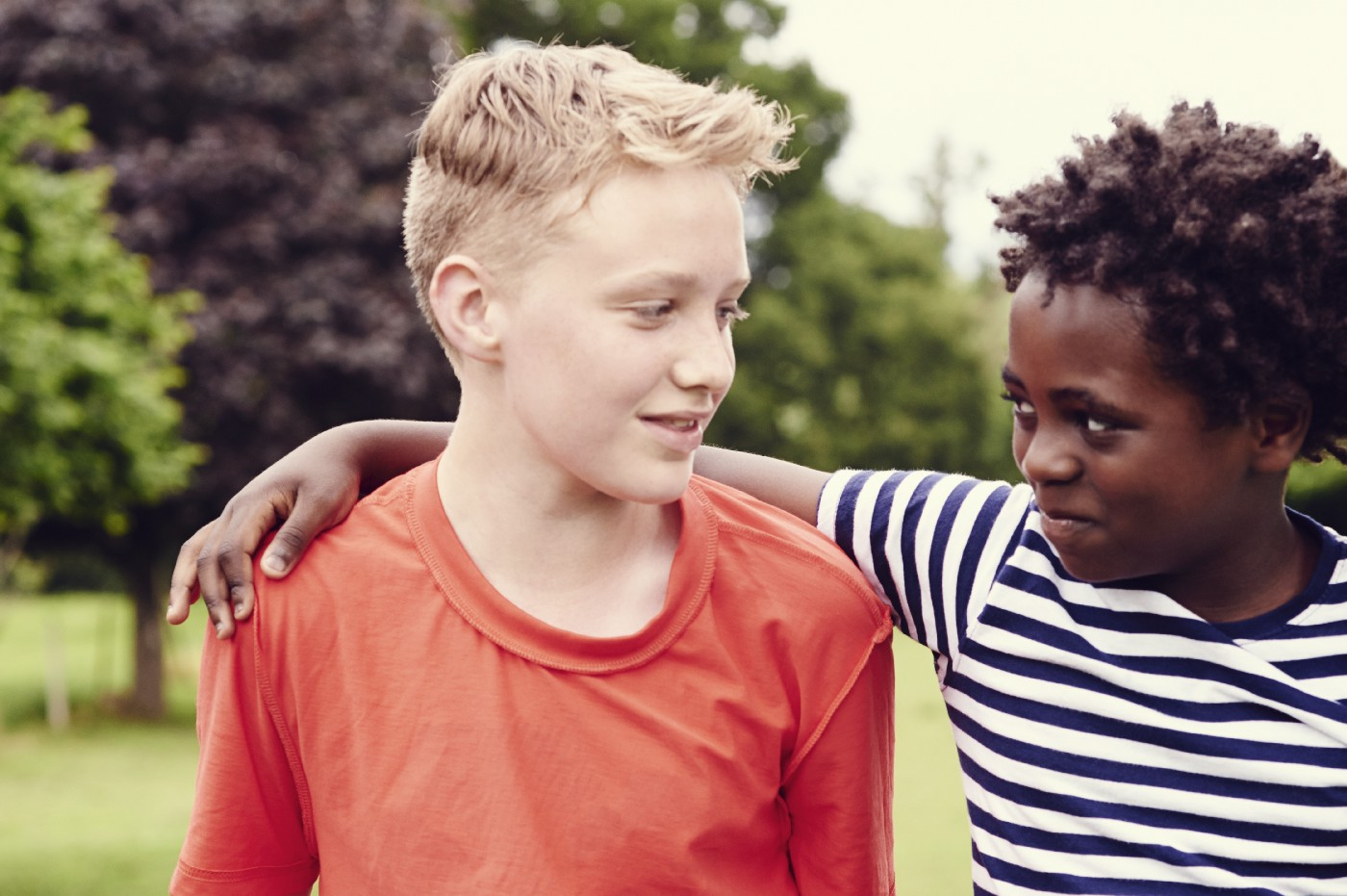 Portrait of a black boy standing with a white boy.