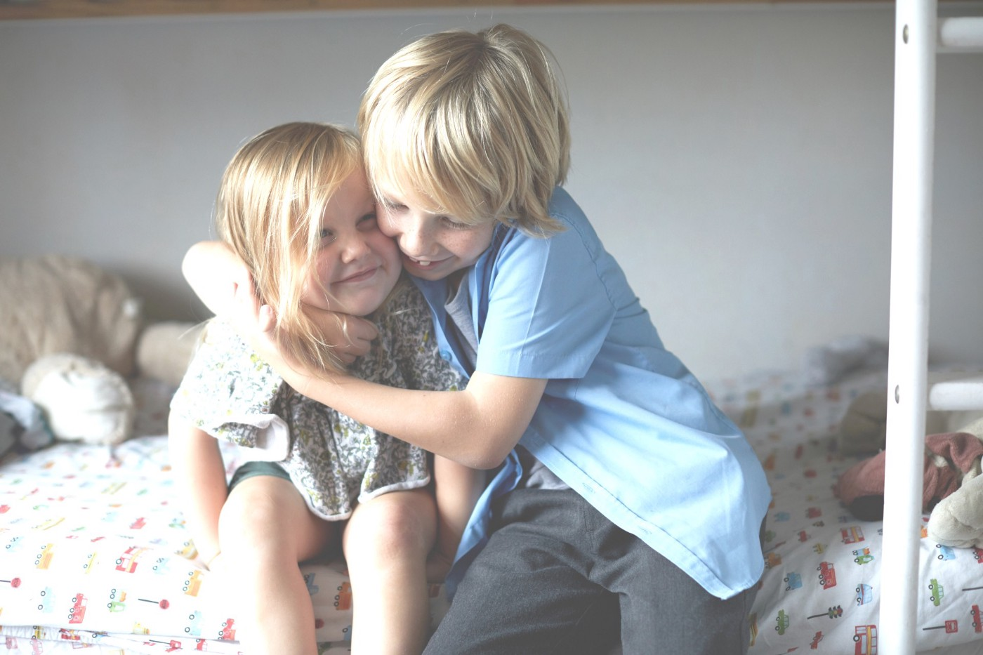 Brother hugging his sister.