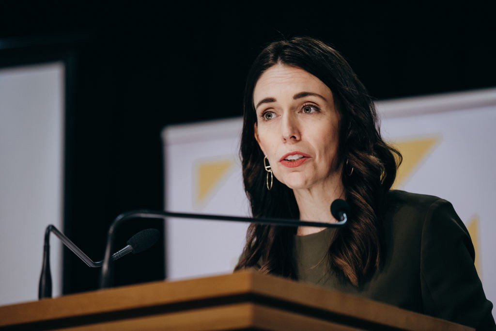 A photo of Jacinta Ardern, the Prime Minister of New Zealand, giving an address.