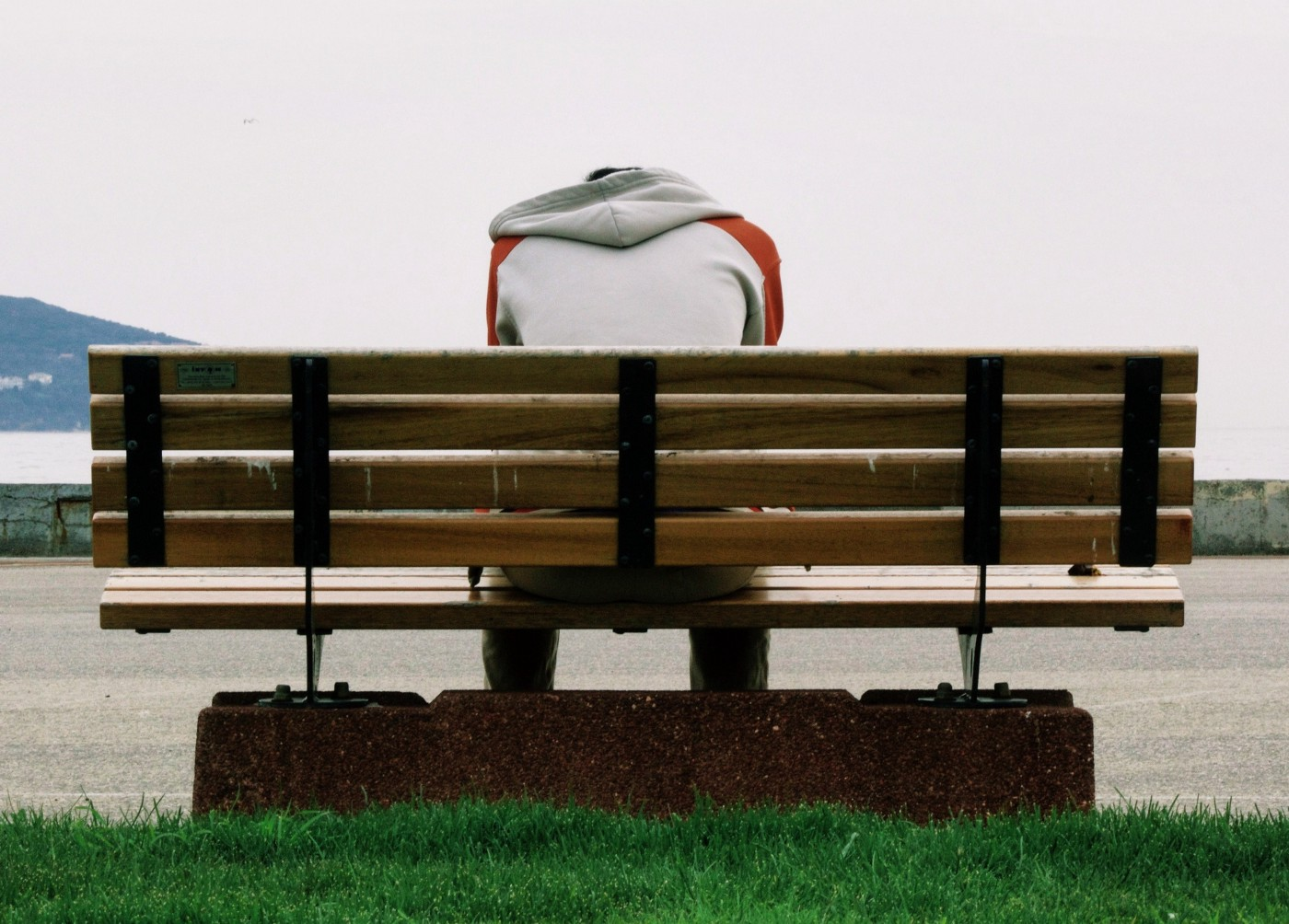 Desperate guy sits on bench