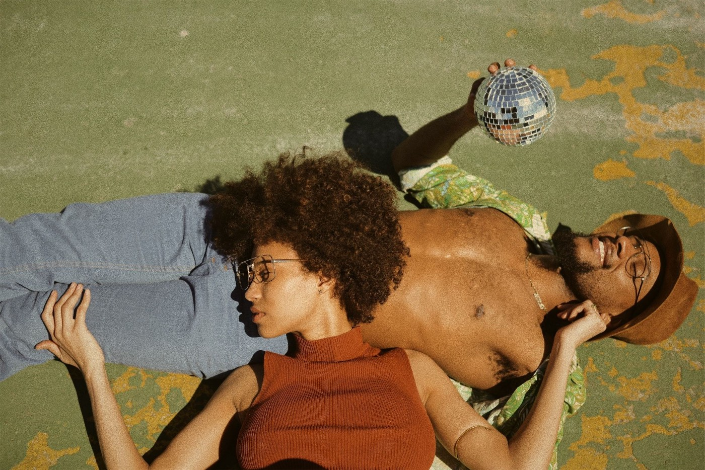 black man and woman laying on the ground