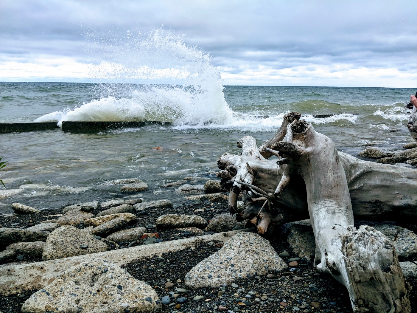 I Second That Emotion, shown here in drab overcast beach colors with the lake churning up a gnarly crashing wave overtaking the breakwall.