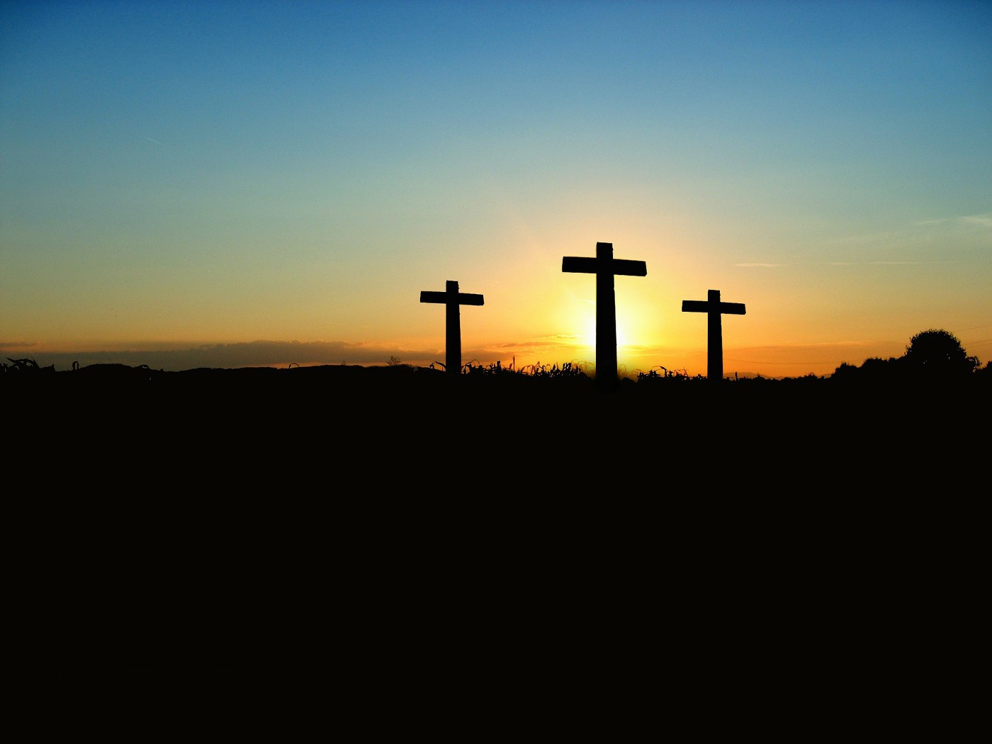 sunset and three crosses
