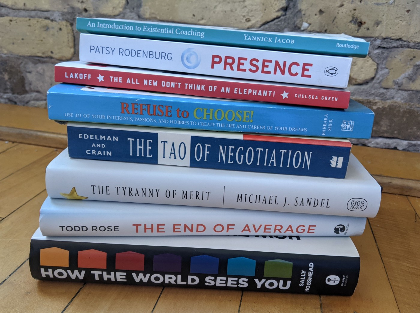 A stack of 8 of the 11 books the author writes about.