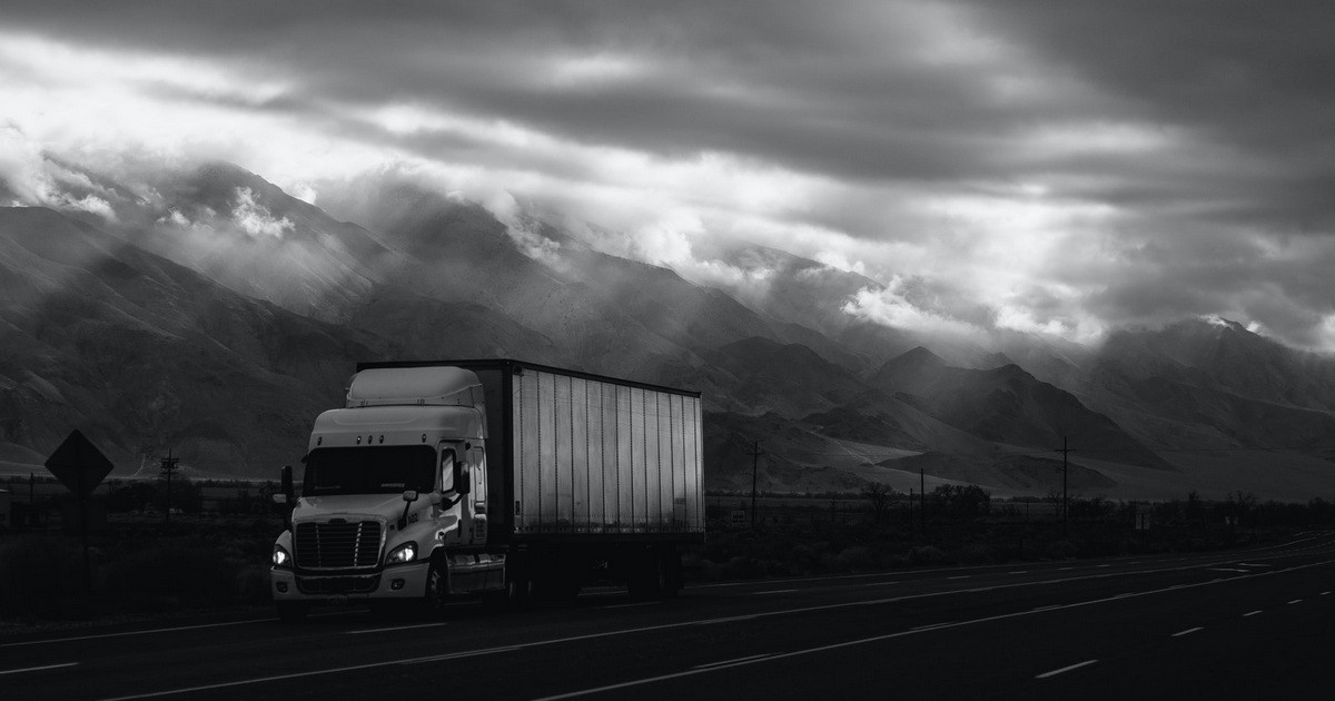 Truck travelling lonely highway.