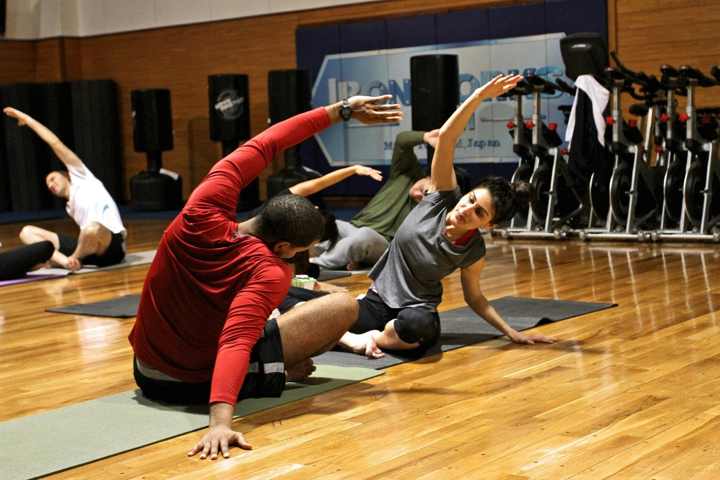 Active men and women engage in workouts to keep fit and healthy