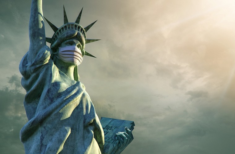 The Statue of Liberty, wearing a face mask