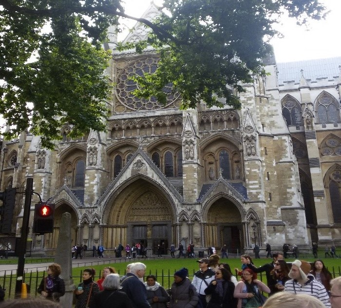 Crowds outside Westminster Abbey on a dark day
