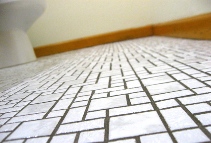Photo taken from the perspective of lying on a tiled bathroom floor.