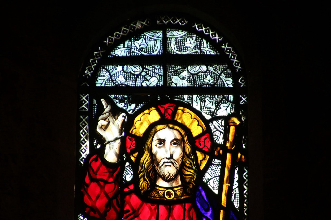 A colored window with Jesus Christ