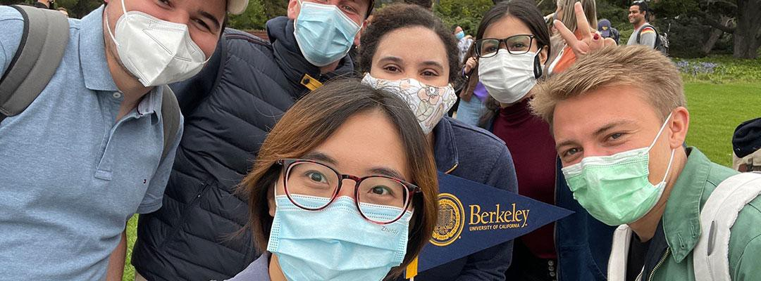 Selfie of students on campus wearing face masks