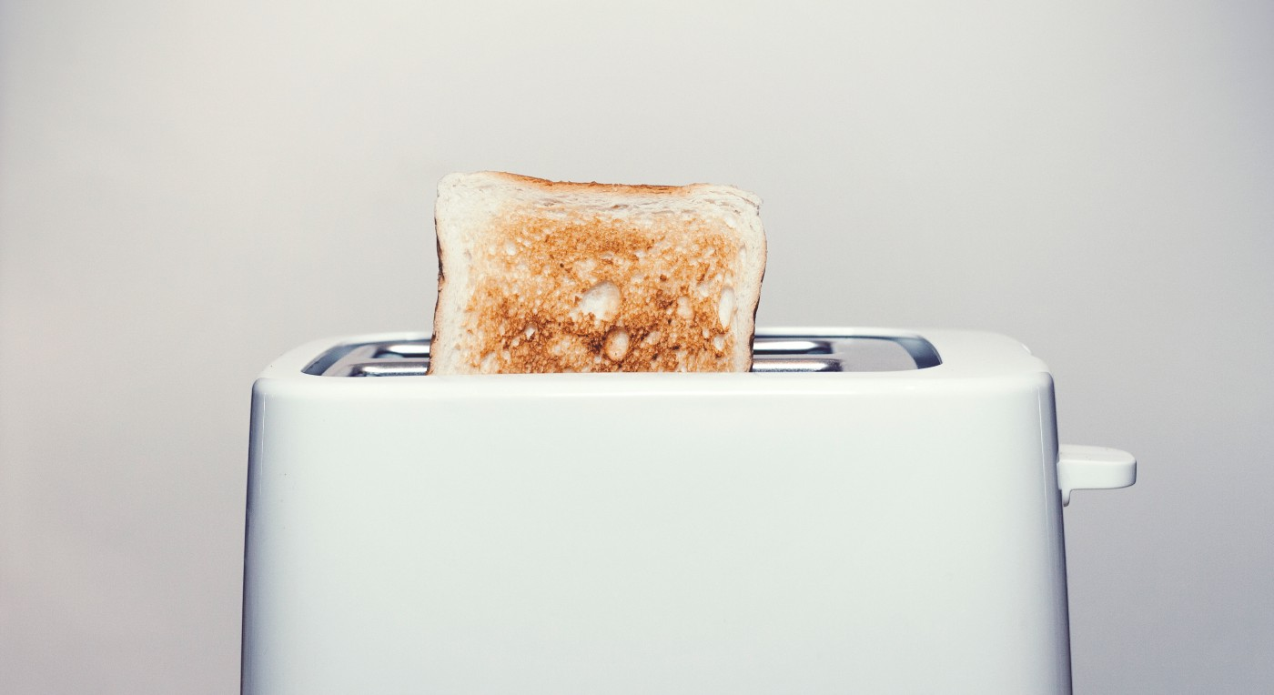 Picture of a toaster with toast sticking out