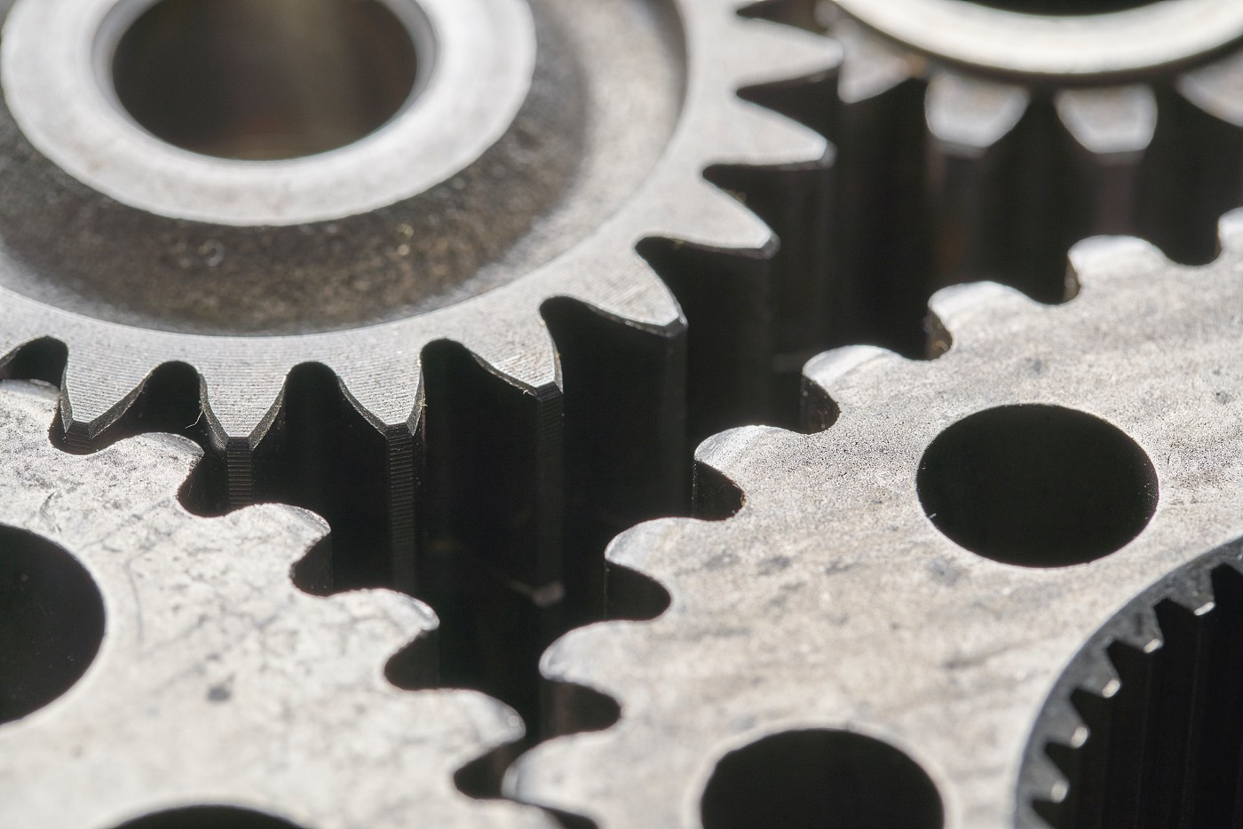 An image of gear cogs interleaved together.