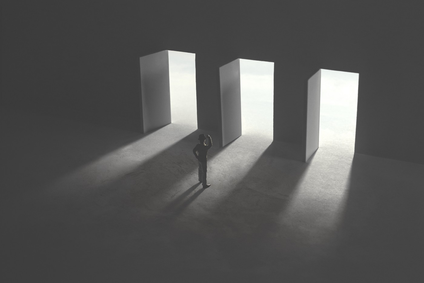 A silhouette of a business man contemplating while standing in front of three open doors.