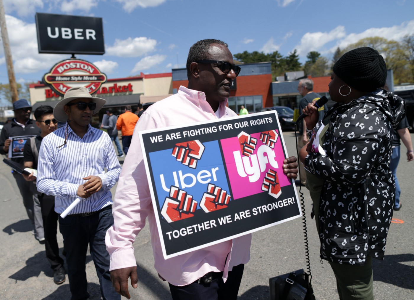 Uber and Lyft drivers protest outside the Uber offices in Saugus, MA.