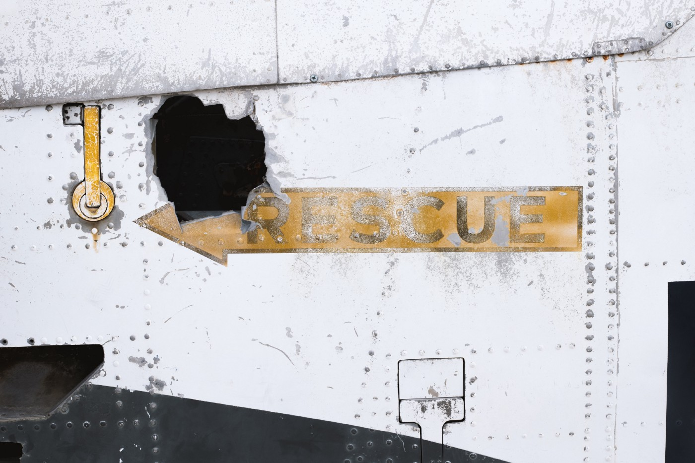 "Sign with an arrow image reading ""Rescue"""