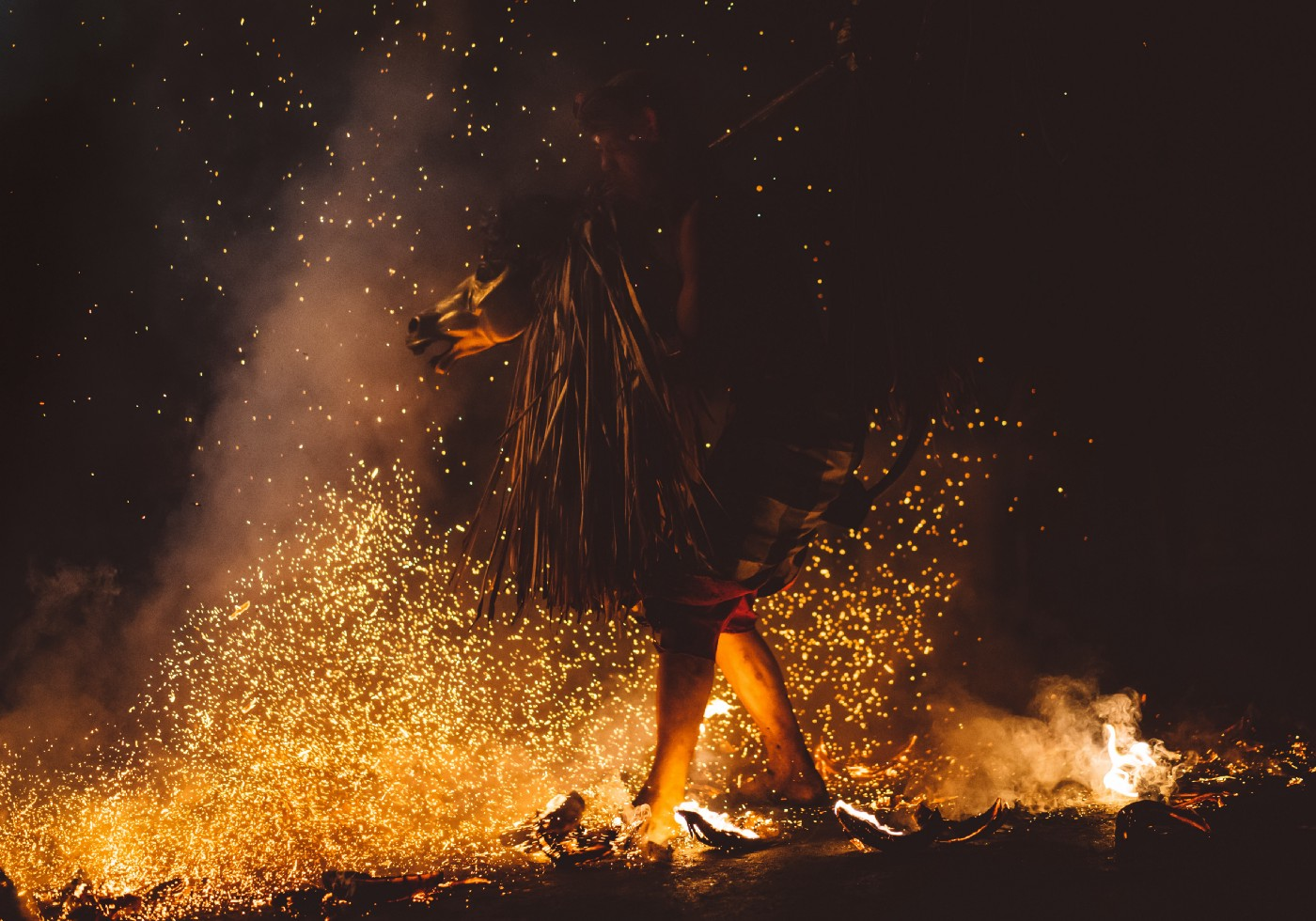 An image of a person dancing in front of fire.